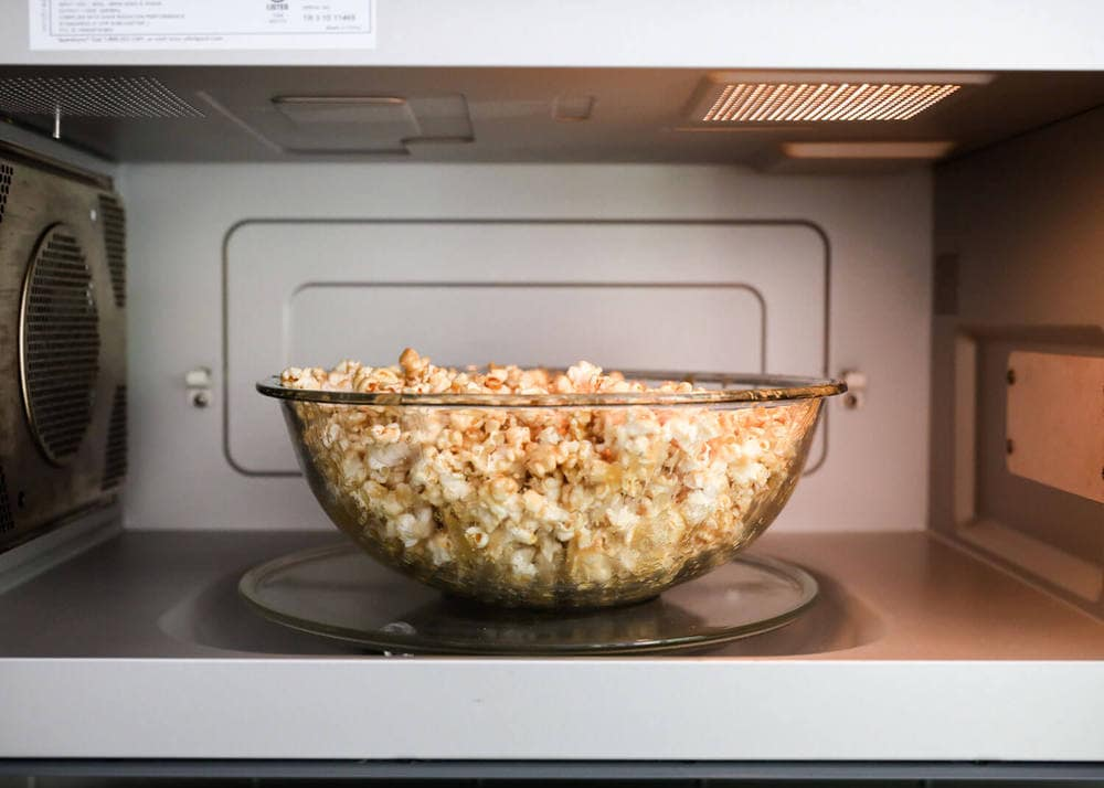 bowl of caramel corn in the microwave
