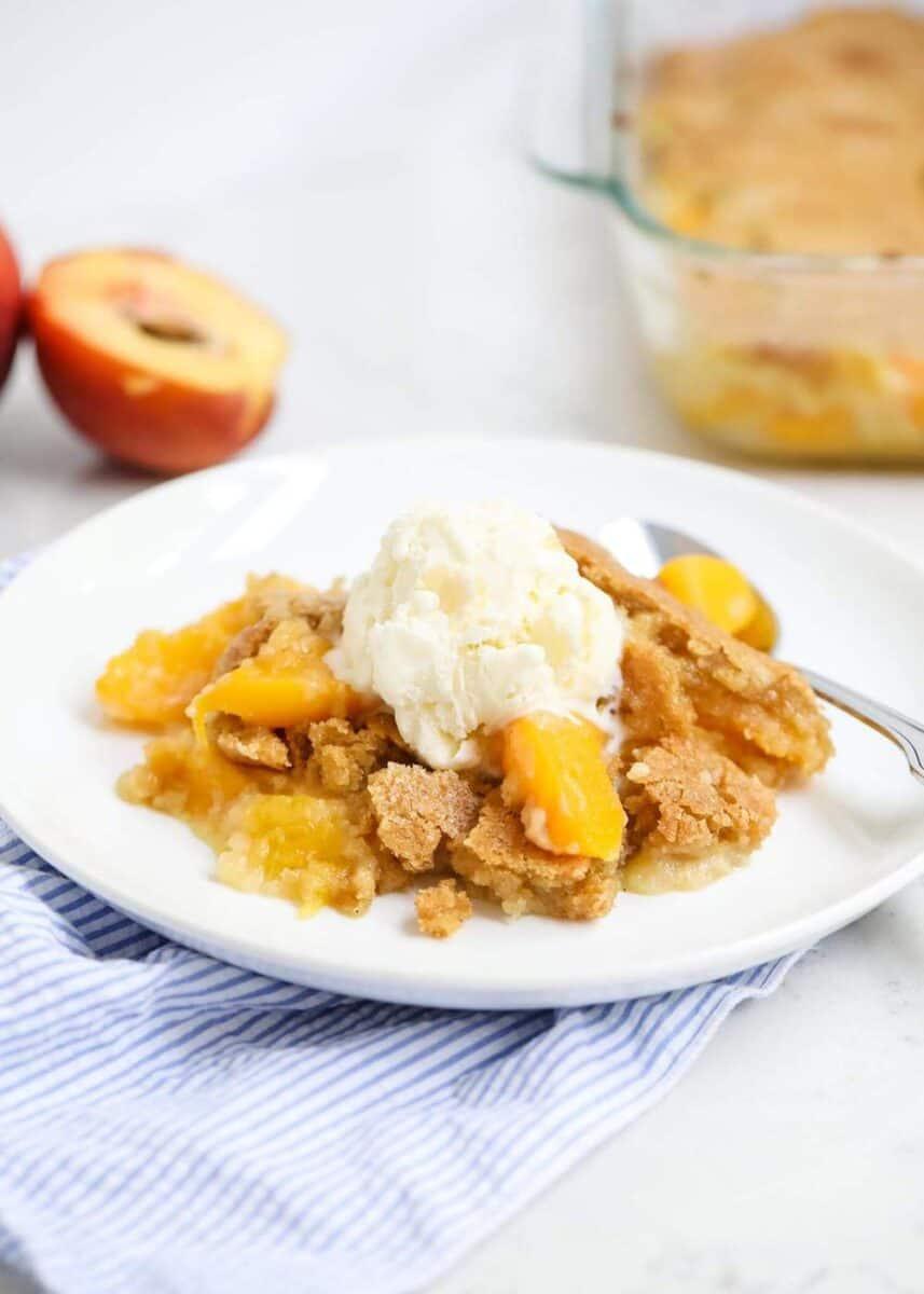 peach cobbler on a white plate