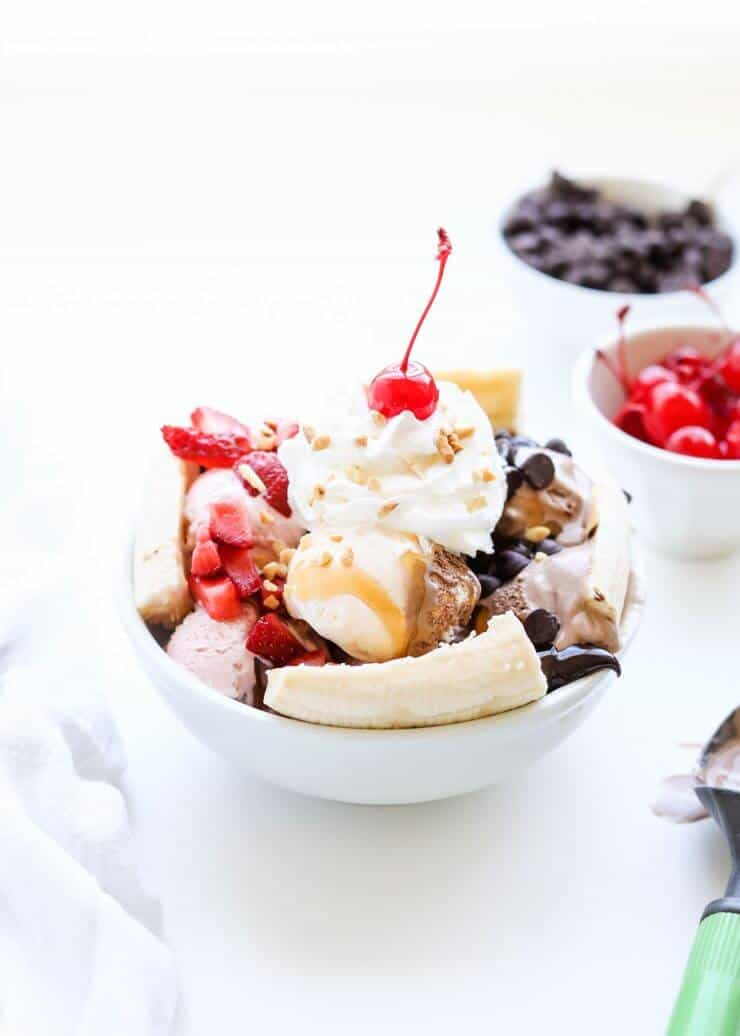 banana split dessert in a white bowl