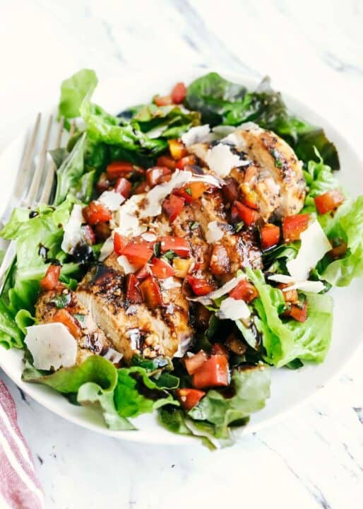 bruschetta chicken on a bed of lettuce