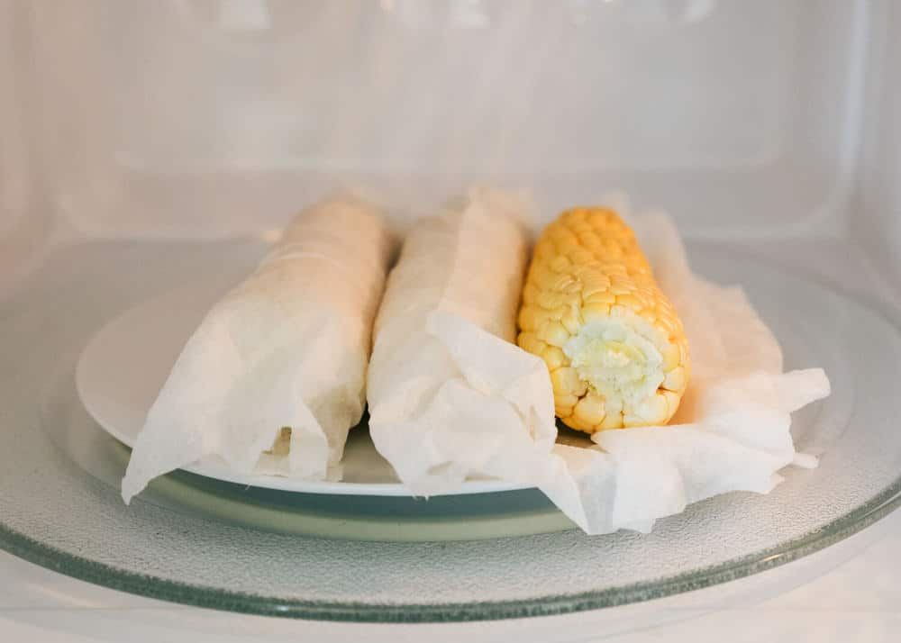 corn on the cob wrapped in damp paper towels in microwave