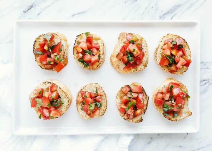 toasted baguette slices with homemade bruschetta on top