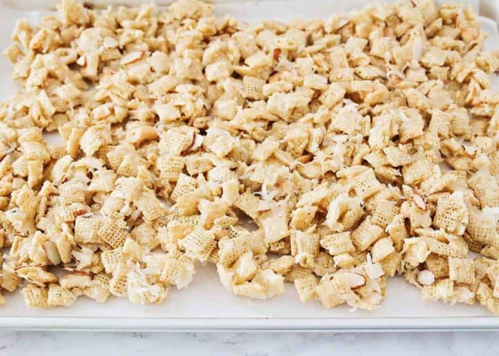 sweet chex mix spread out on baking sheet