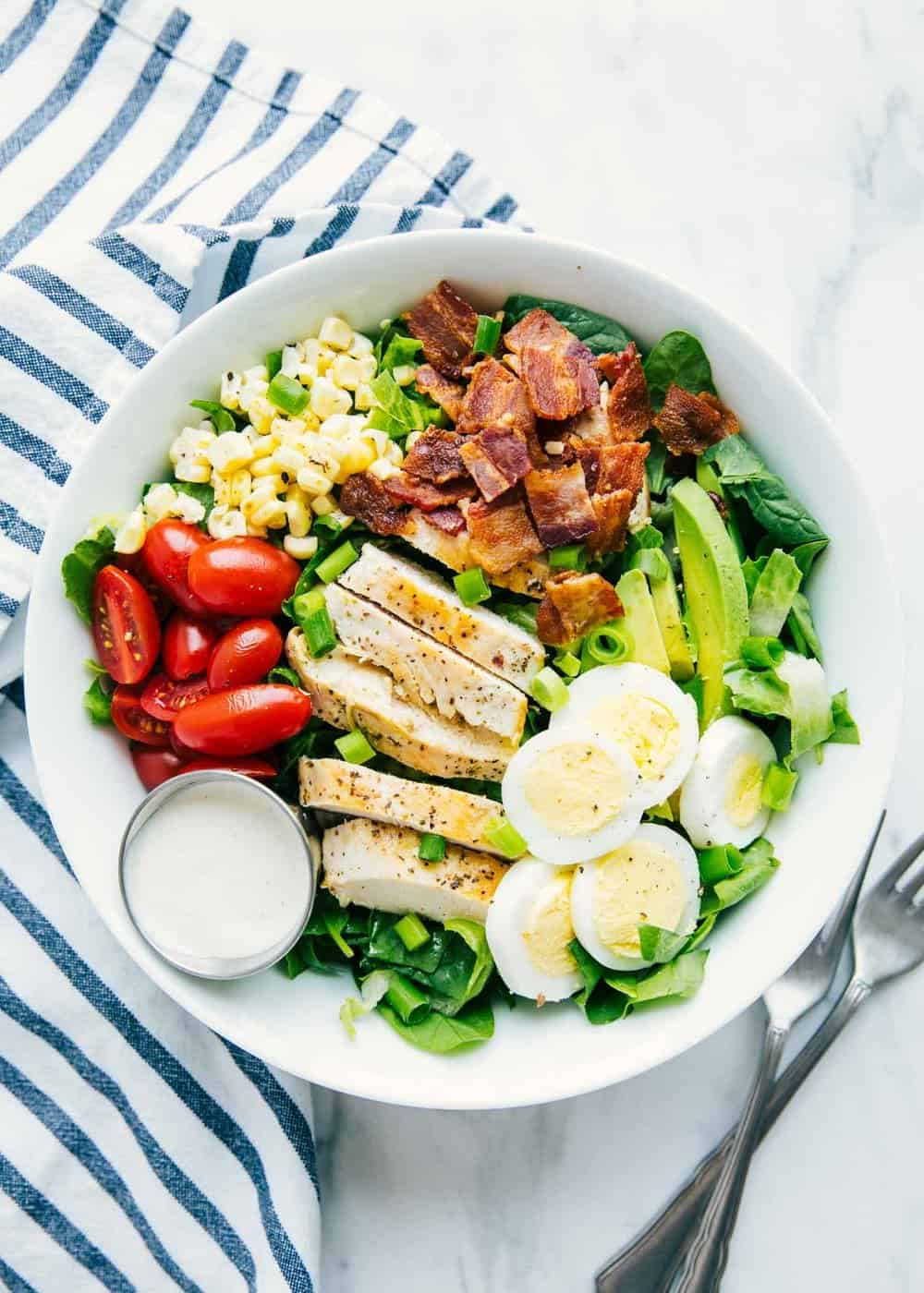 cobb salad in a bowl with dressing