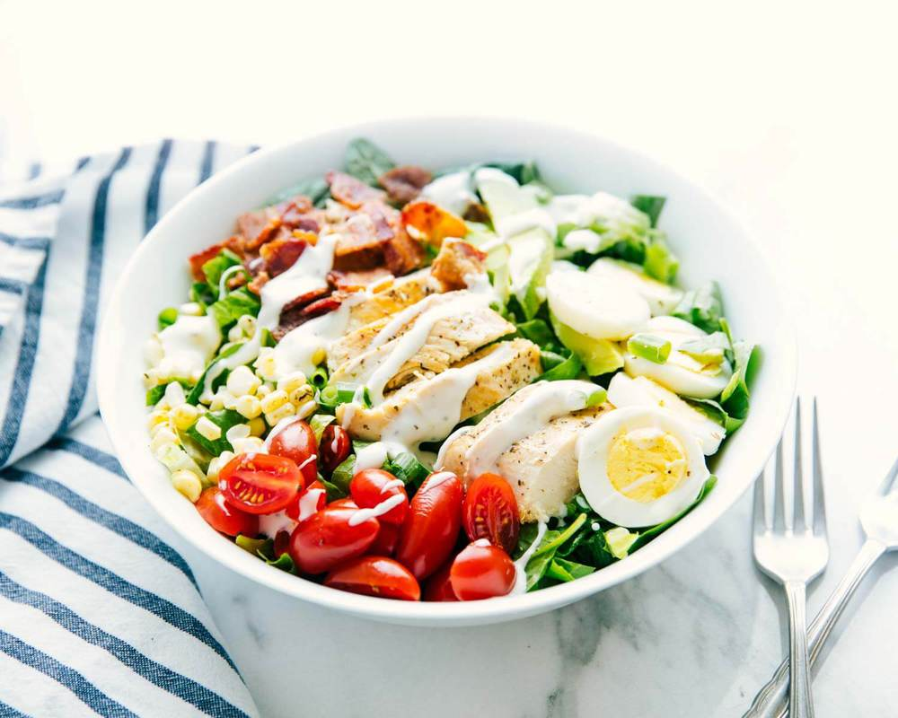 chicken cobb salad in a large bowl