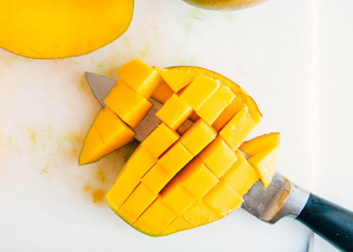 slicing a mango into cubes