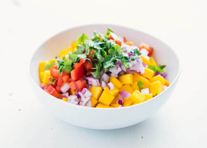 ingredients for mango salsa in a bowl
