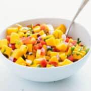 mango salsa in a white bowl