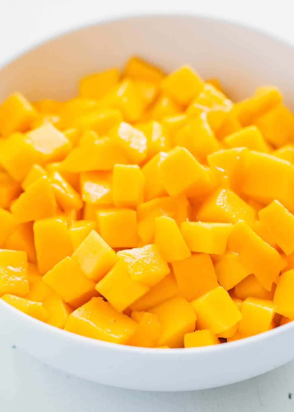 diced mango in a white bowl