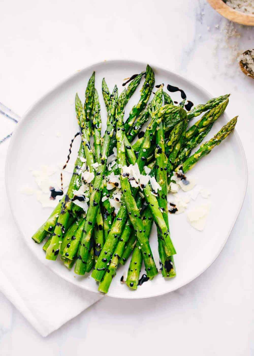 roasted asparagus drizzled with balsamic glaze and fresh shaved parmesan
