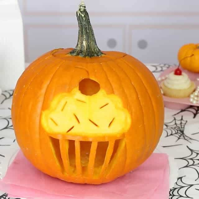 Cupcake Jack o Lantern + 25 Clever Pumpkin Carving Ideas - creative and adorable pumpkin carving ideas that will bring the whole family together for this favorite fall activity!