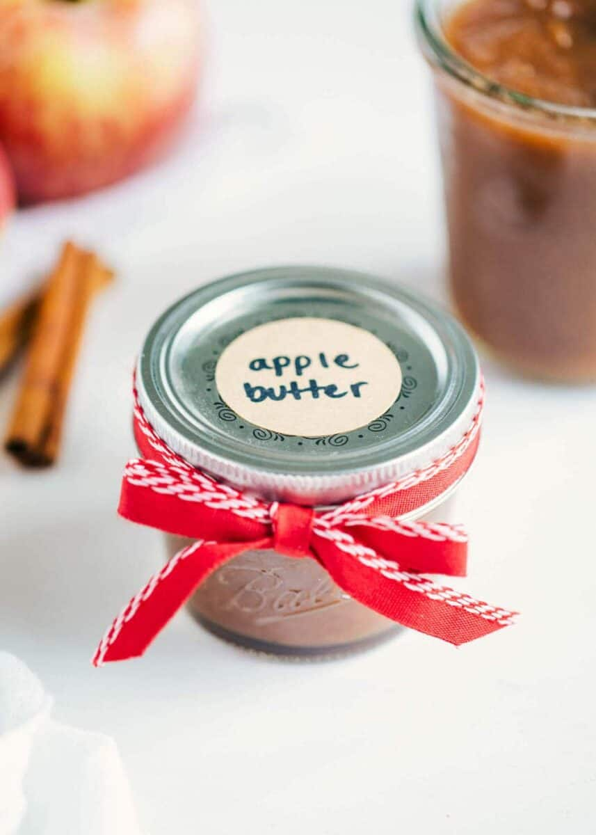 apple butter in small jar with label and ribbon