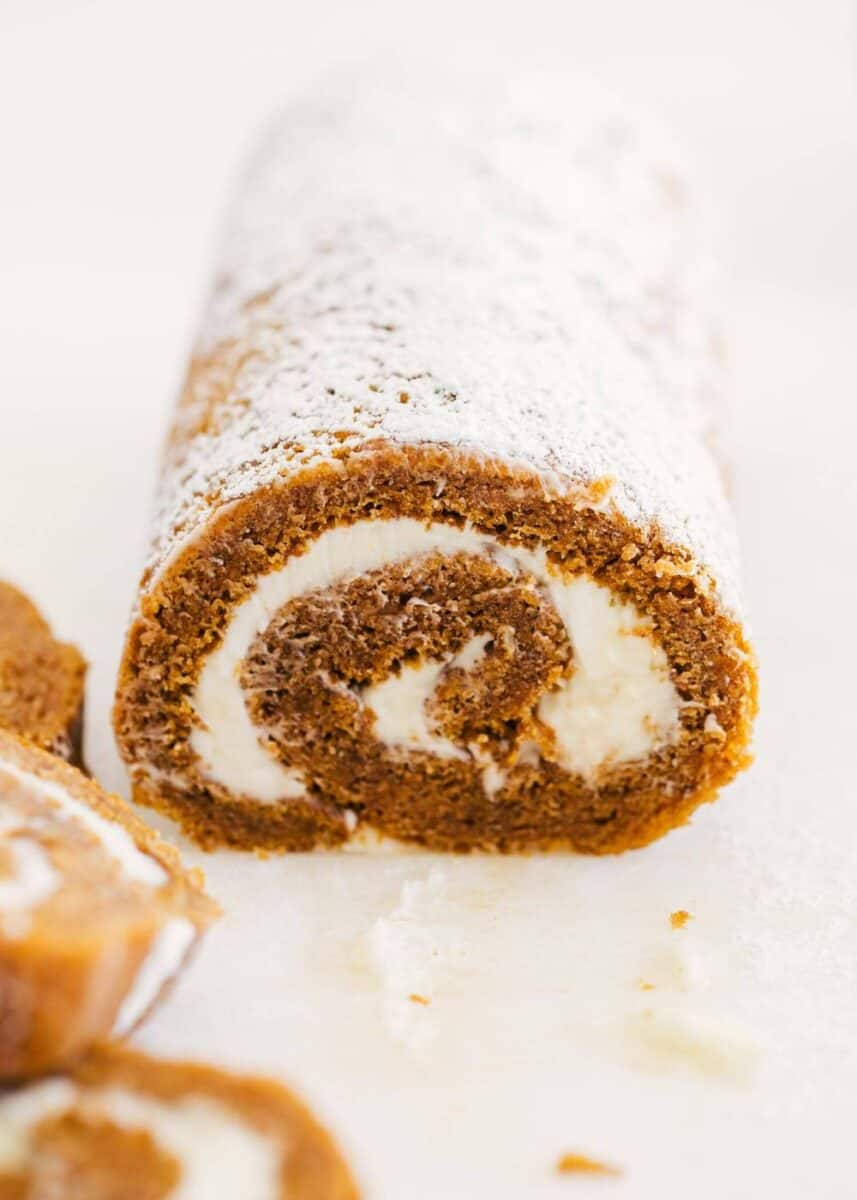 pumpkin roll dusted with powdered sugar