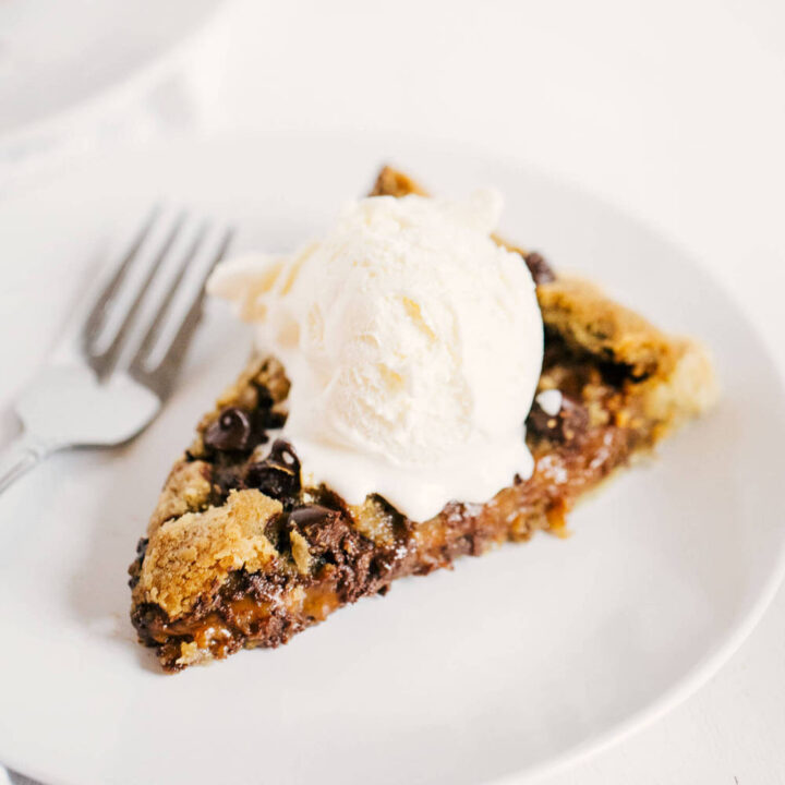 slice of chocolate chip cookie pie in plate
