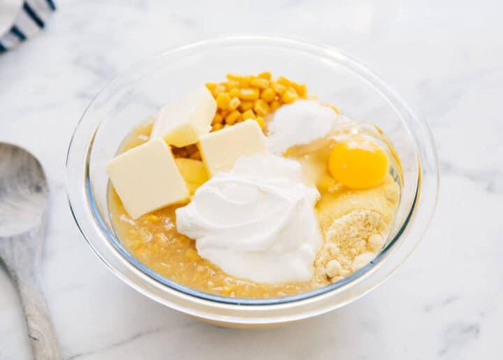 corn casserole ingredients in glass bowl