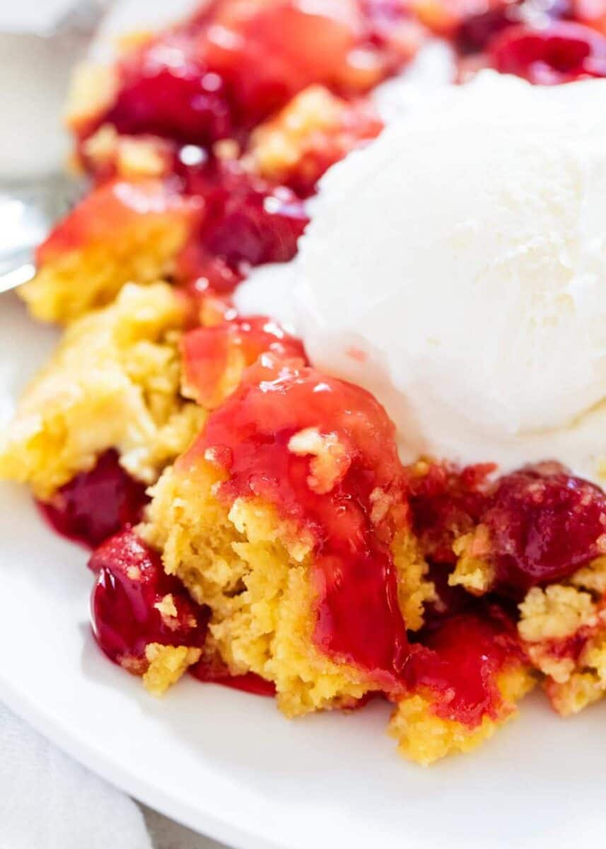 cherry dump cake with a scoop of vanilla ice cream on top