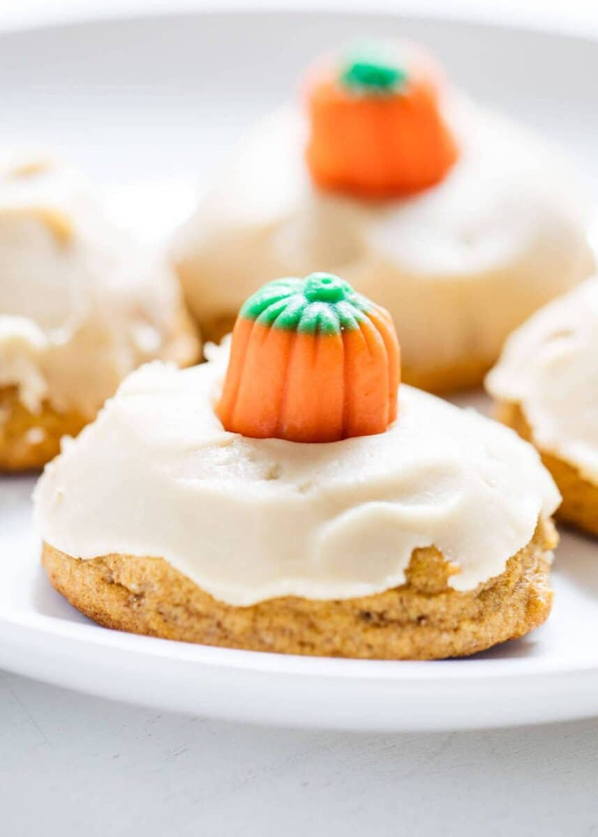 frosted pumpkin cookies topped with candy pumpkin