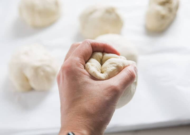 forming dough into a ball with hands