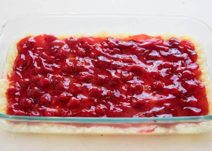 cherry pie filling and crushed pineapple in a baking pan