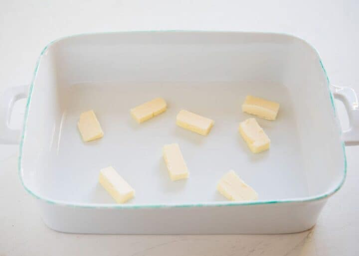 sliced butter in a baking dish
