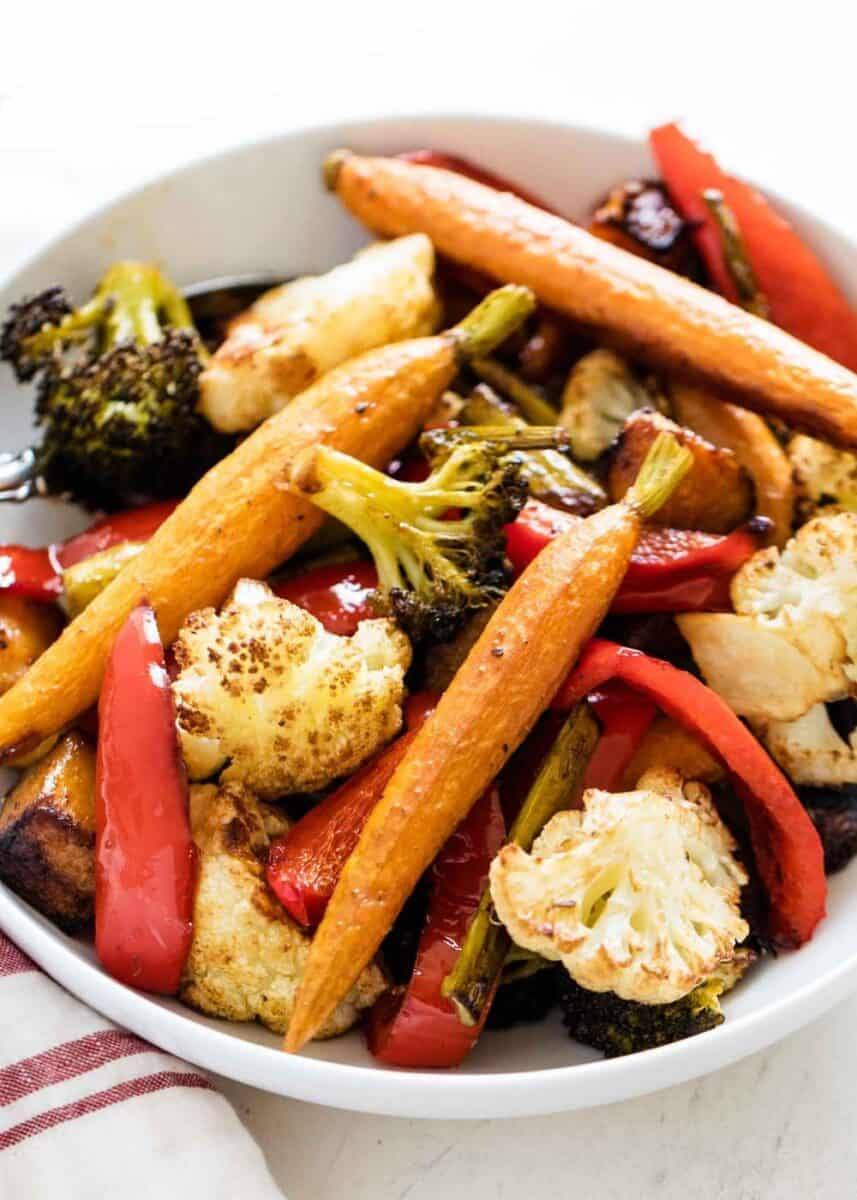 baked vegetables in a white bowl
