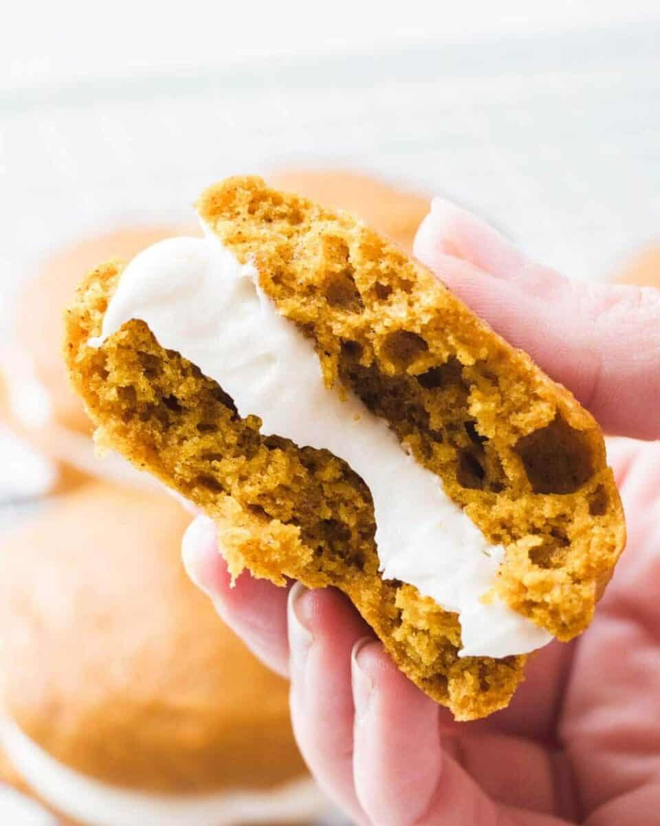 pumpkin whoopie pie with bite taken out