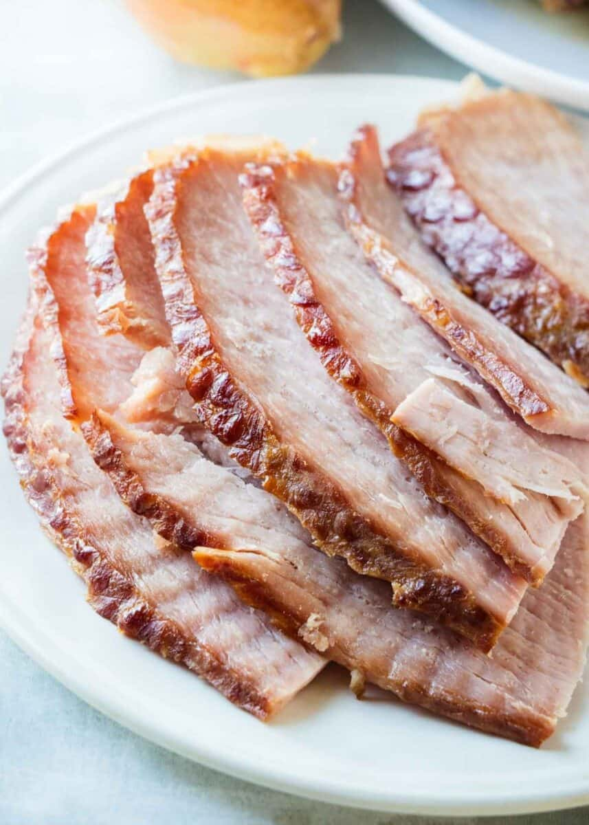 slices of spiral ham on a white plate