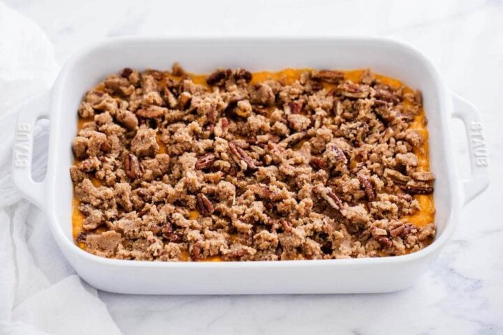 unbaked sweet potato casserole in baking dish