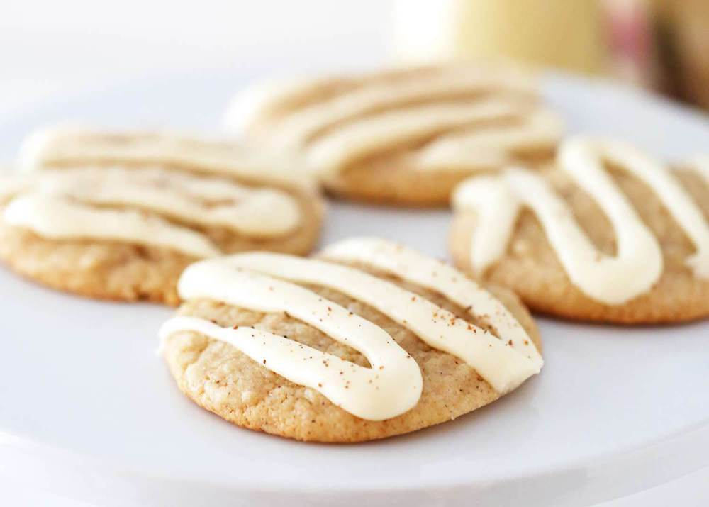 eggnog cookies with icing on a white plate