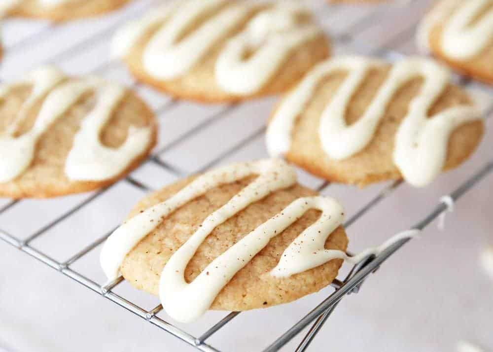 iced eggnog cookies on a cooling rack