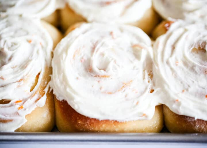frosted orange rolls in pan