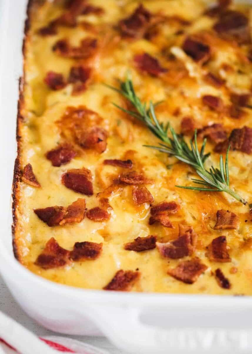 scalloped sweet potatoes with bacon in pan