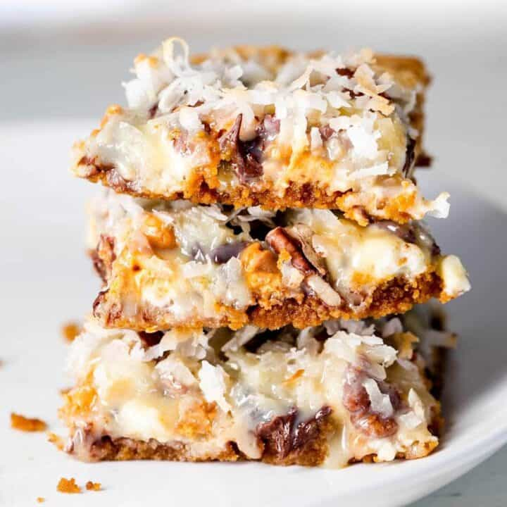 stack of 7 layer bars on a white plate