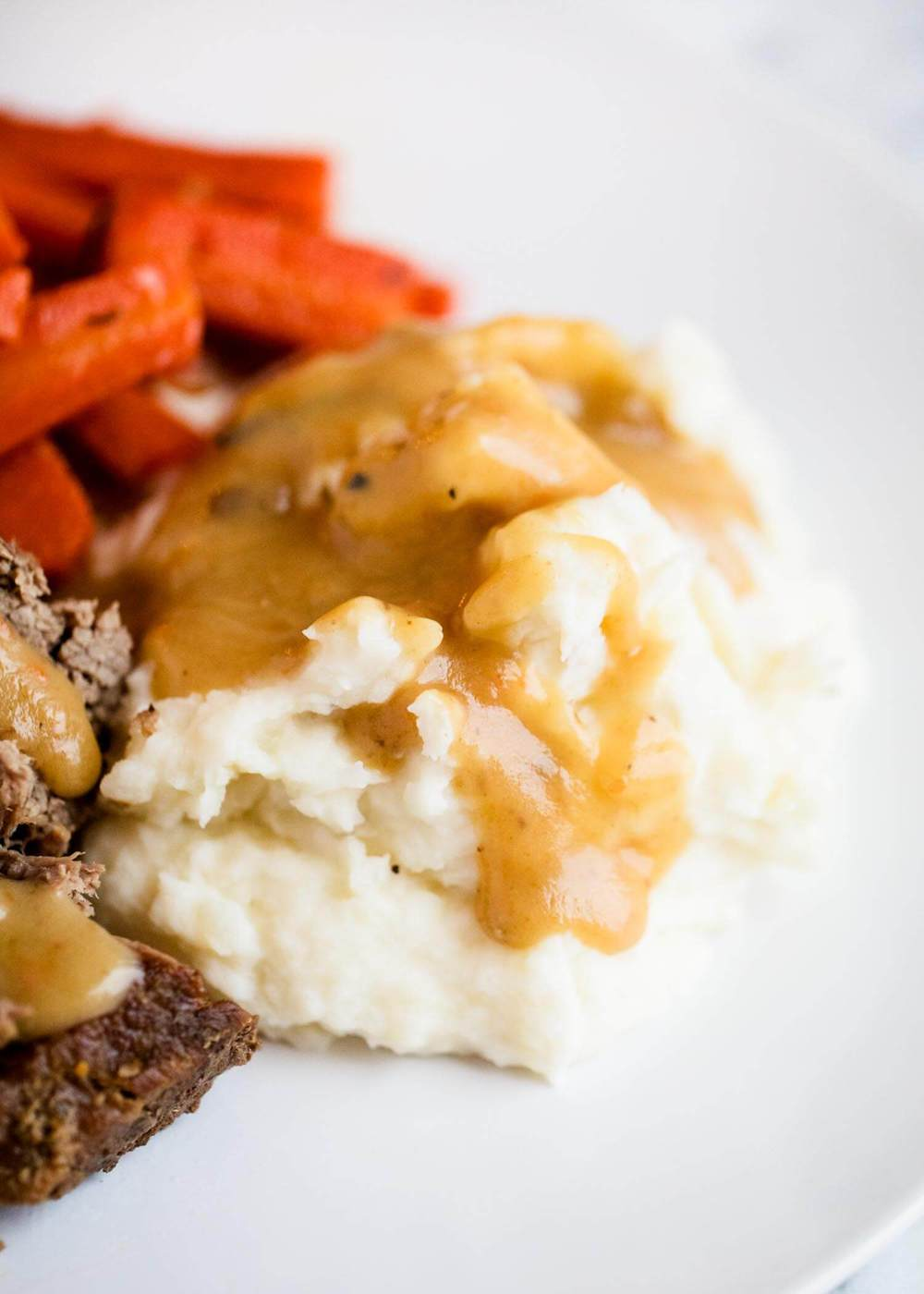 pot roast, carrots and mashed potatoes with gravy on top