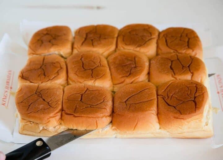 slicing Hawaiian rolls