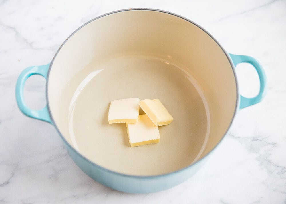 adding butter to a large pot for homemade gravy