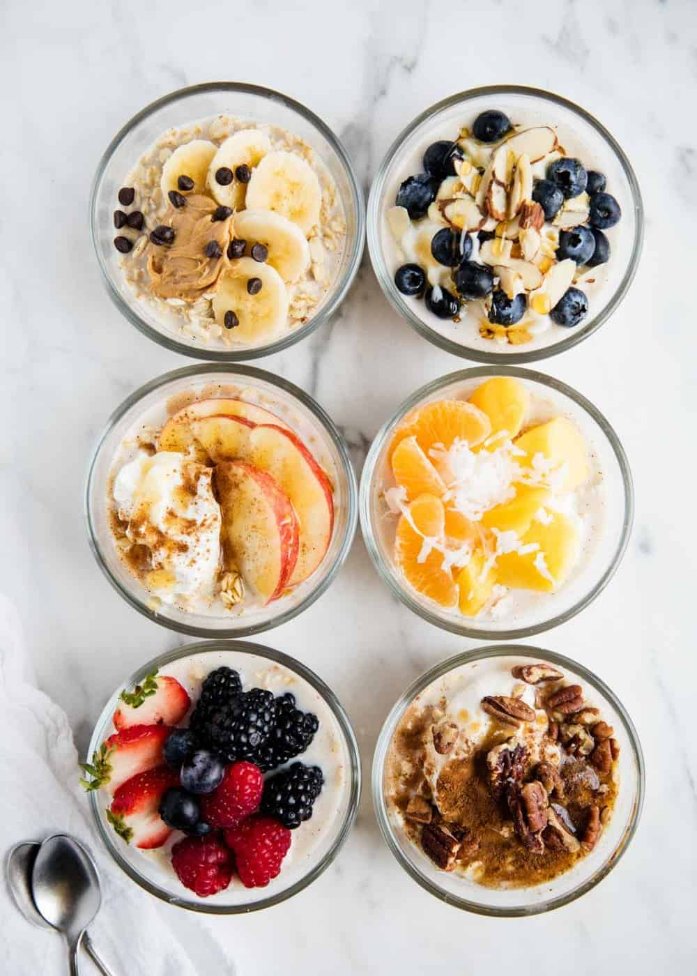 6 different combinations of overnight oats on counter