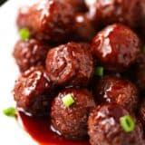 bbq meatballs with chopped scallions on top