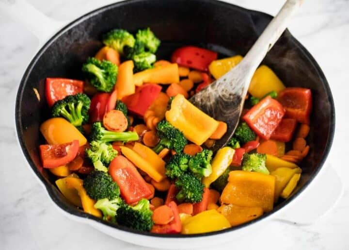 cooking stir fry vegetables in pan
