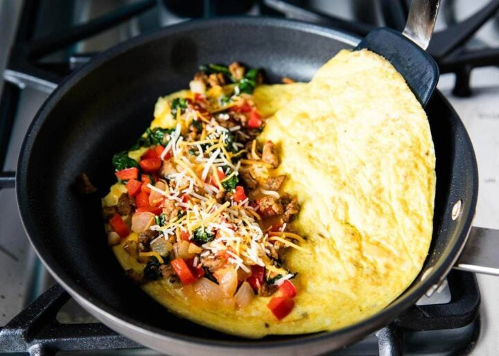 folding omelette in skillet