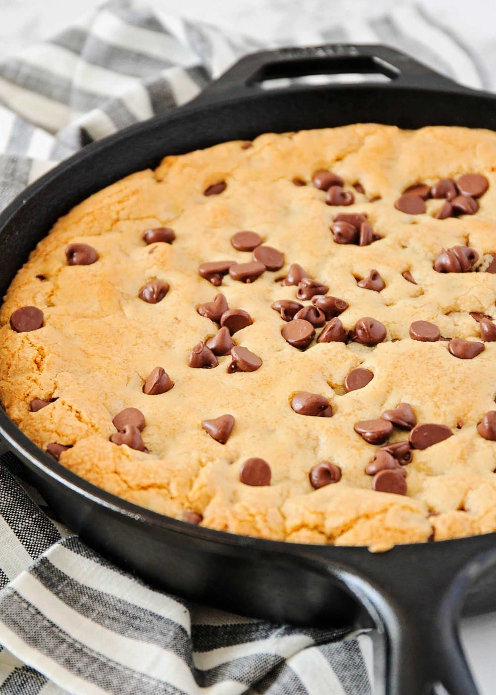 chocolate chip cookie in a cast iron skillet
