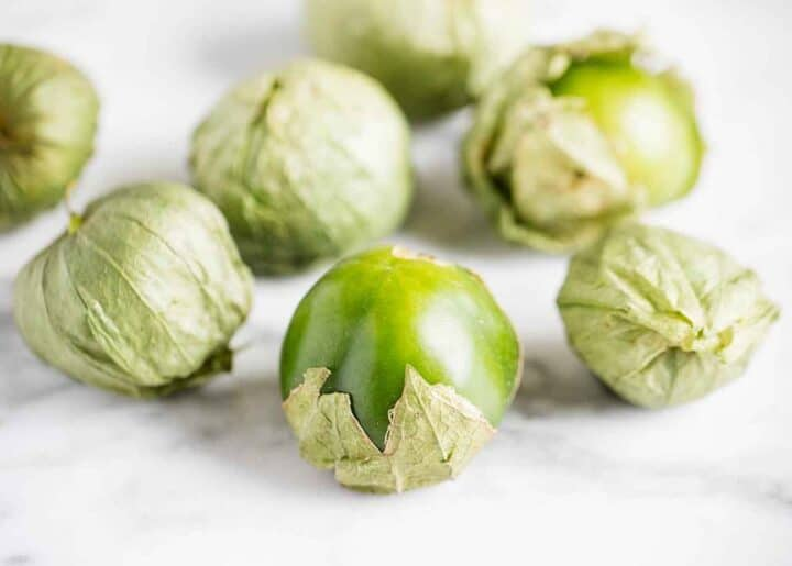 fresh tomatillos on counter