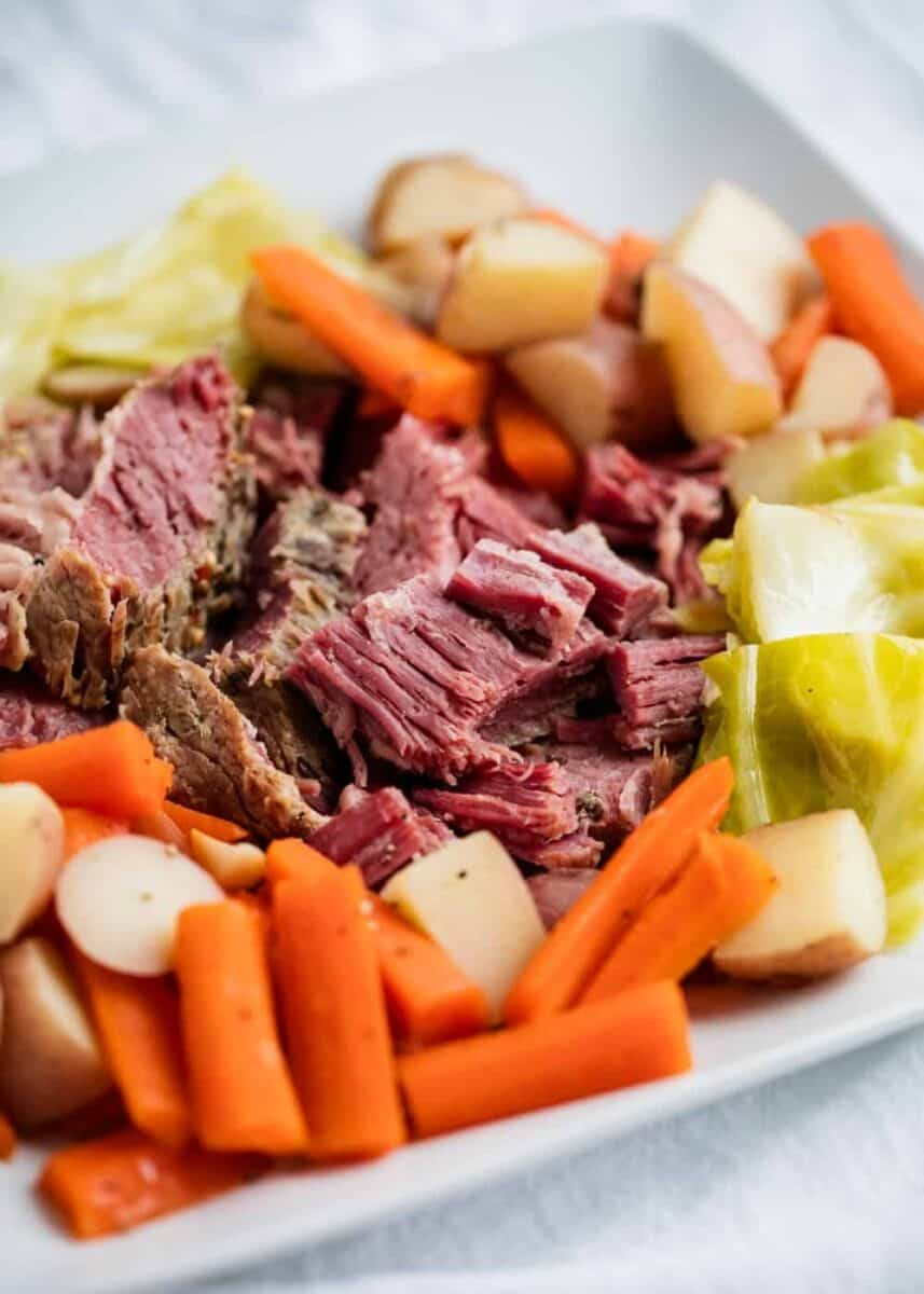 corned beef, cabbage, carrots and potatoes on white plate