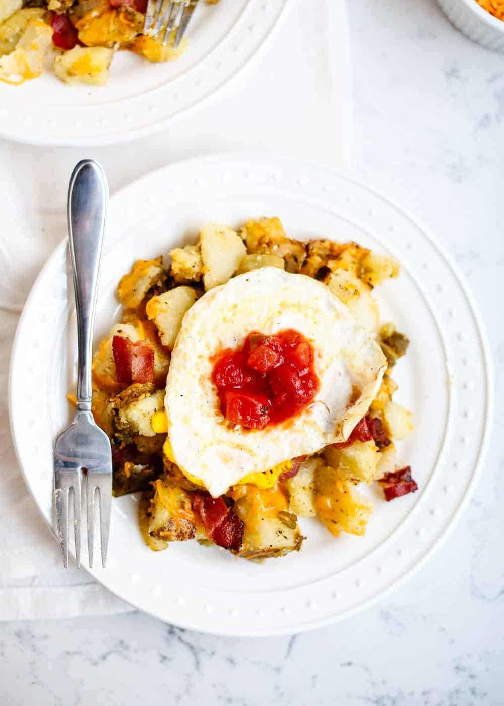 breakfast potatoes and egg on plate