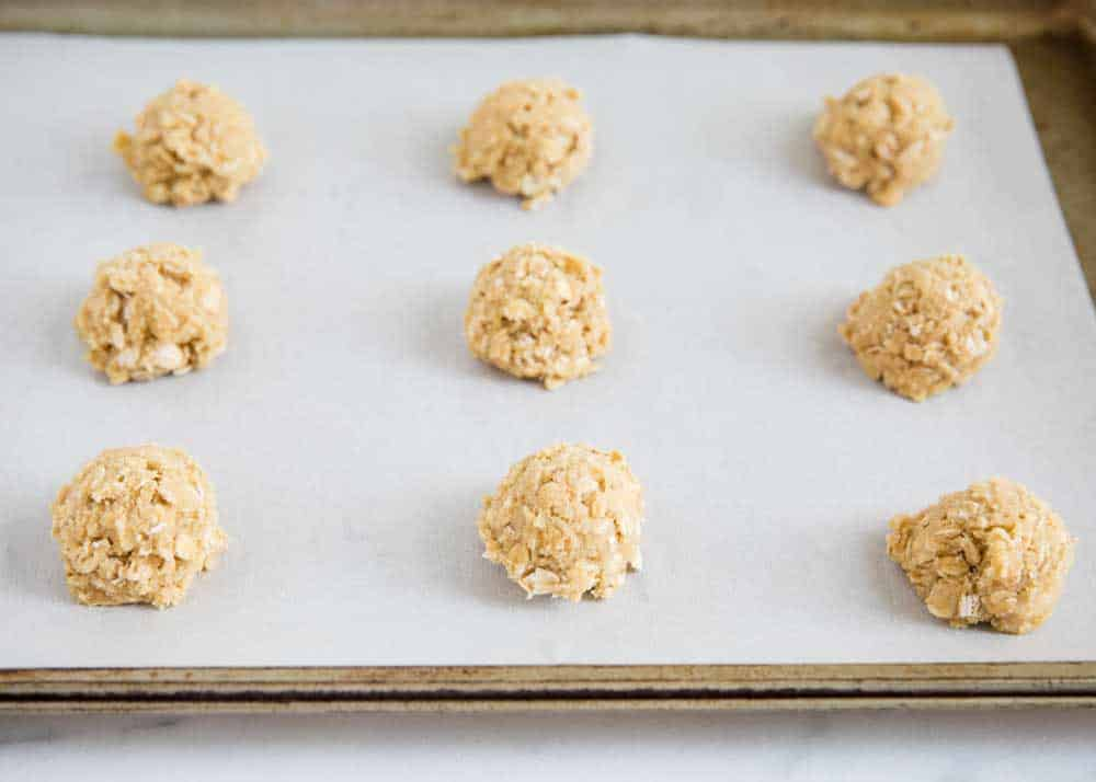 oatmeal cookie dough balls on baking sheet