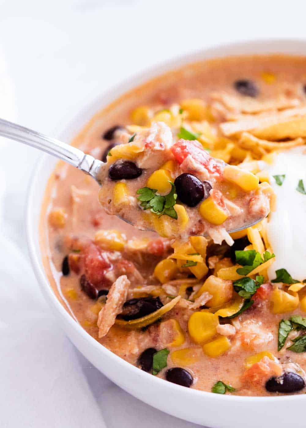 bowl of chicken enchilada soup with a spoon