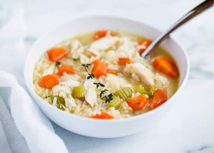 chicken and rice soup in a white bowl