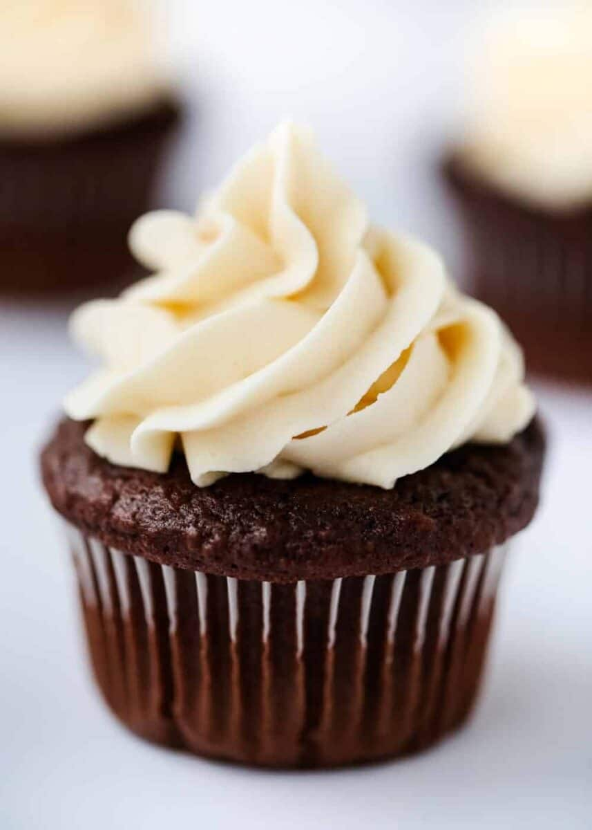 close up of a chocolate cupcake with buttercream frosting