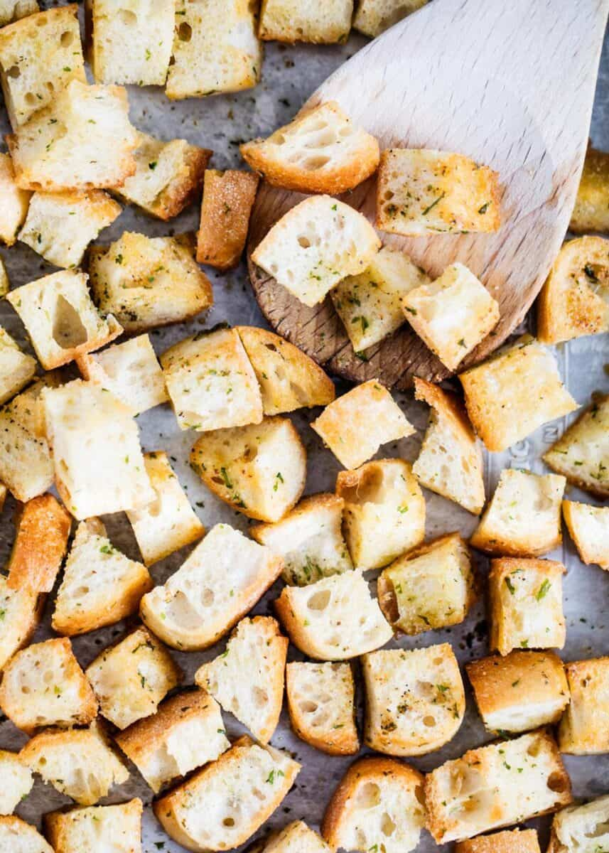 croutons baked on a pan with wooden spoon