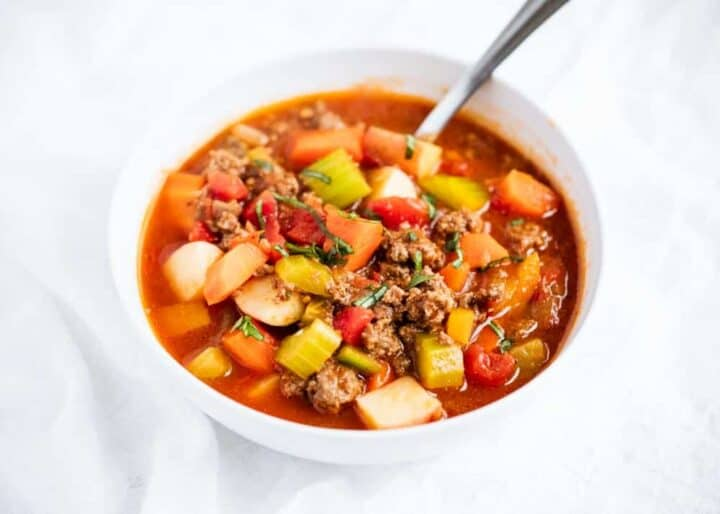 vegetable beef soup in white bowl